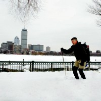 Pete Yogey is out skiing on snow covered st. in Boston