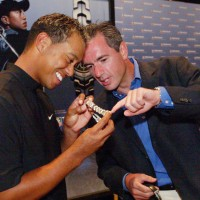 Tiger Woods admires his Swiss watch