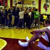 BU's Billy Collins sits on the court as UV celebrate
