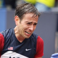 Arnstein reacts after crossing the finish line of the Boston Marathon